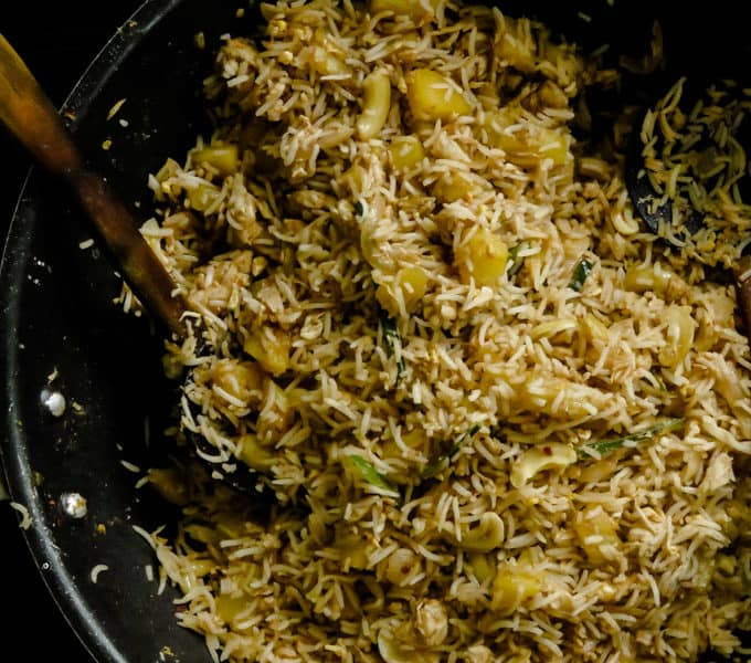 Pineapple chicken fried rice(one-pot meals). Chicken and PIneapple are stir-fried in spices then mixed together with rice to create both a budget-friendly and time- saving one-pot meal.