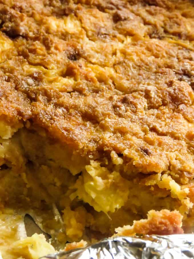Pineapple and bread pudding baked in a pan, serve as savory side dish or dessert with ice cream.