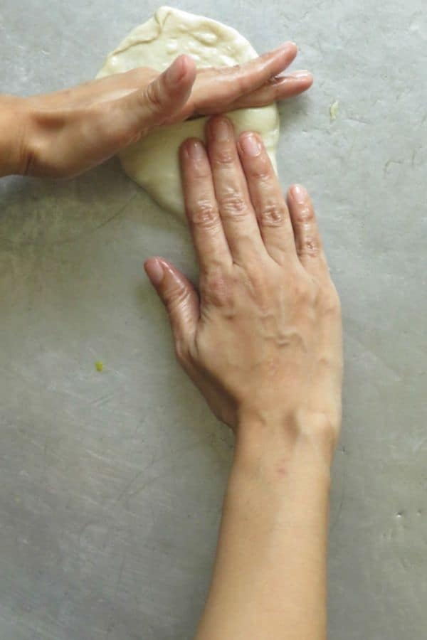 continue to shape and fold the triangle vegetable roti.