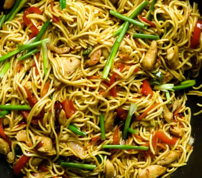a wok full of delicious chicken lo mein noodles.