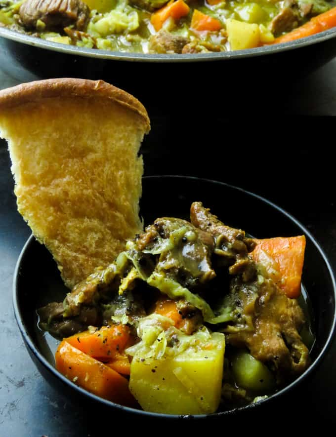 Peppery beef stew with cabbage and bread to eat it.