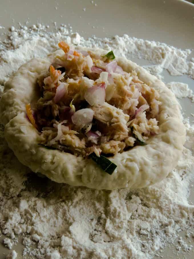 tuna filling placed in a roti dough.