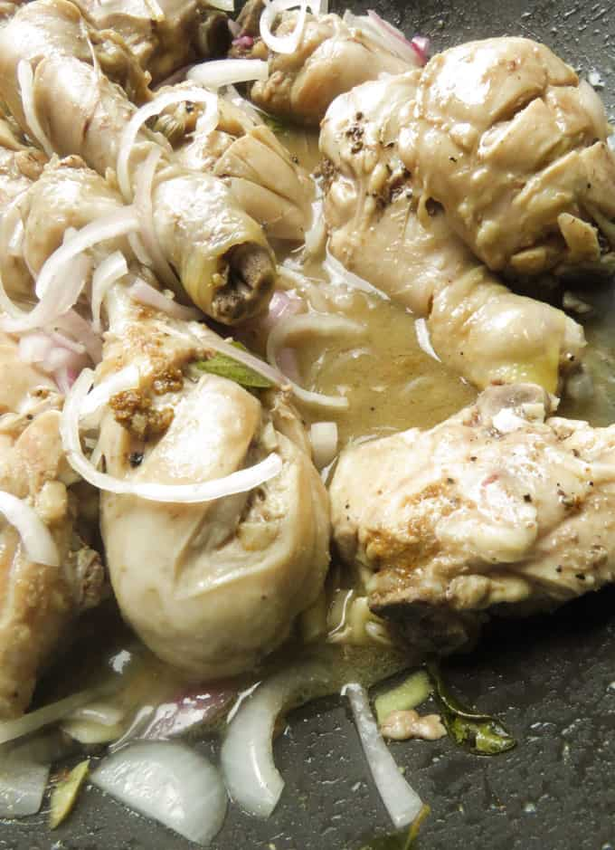 adding onions and pepper to the vinegar chicken.