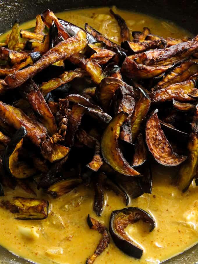 fried brinjals/aubergine in coconut milk curry.