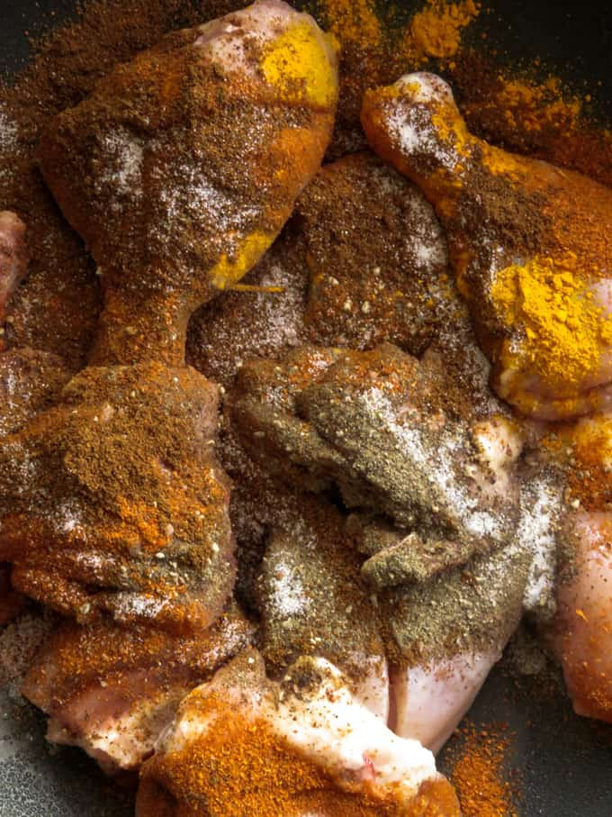 marinating the chicken parts with the curry powders to make the ambulthiyal.