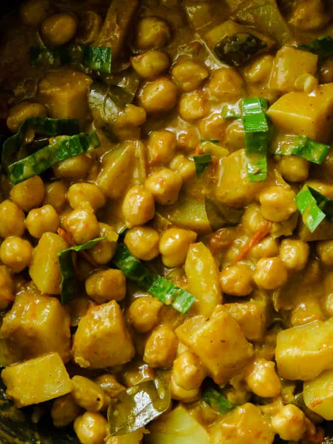 Indian chickpea and potato curry in a pan.