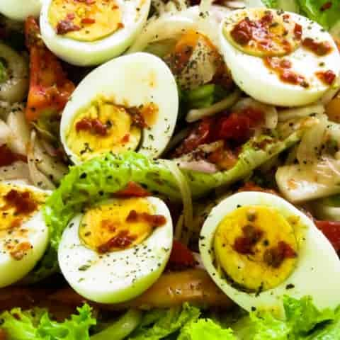 Boiled egg salad(spicy) with onions and tomatoes.
