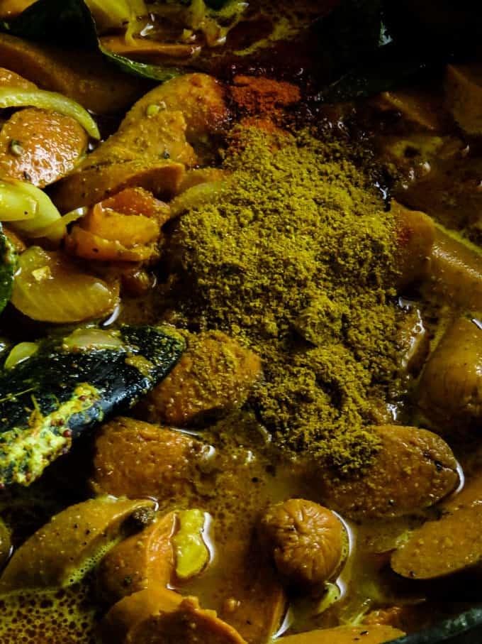adding more spices to the sri lankan curry.