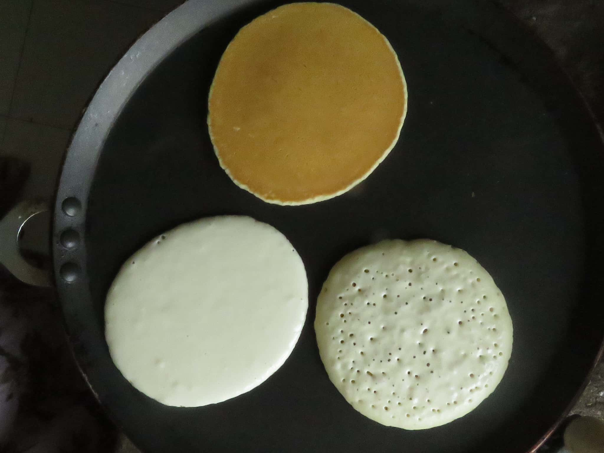 image shows how to cook three pancakes at the same time, the pancakes are in different stages of cooking.