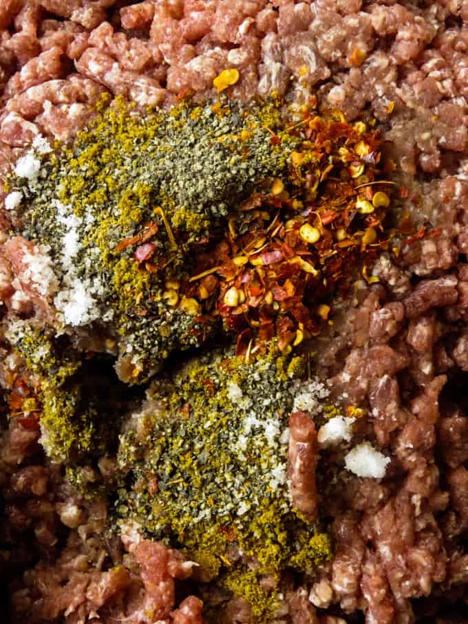 marinating minced beef with curry spices.