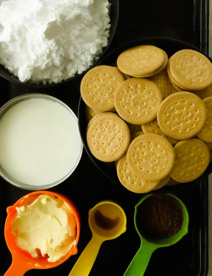 ingredients icing sugar, buiscuits, butter, milk, cocoa powder to make buiscuit pudding.