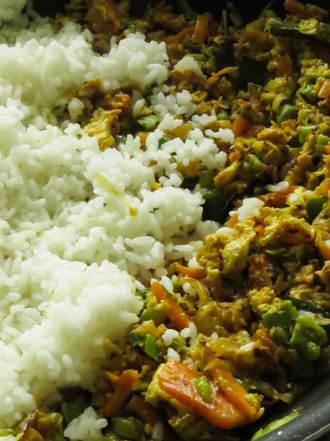 adding the chilled rice to the egg and and vegetable mixture.