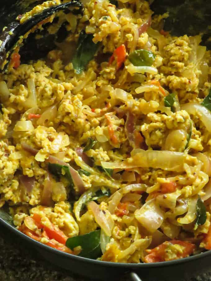 spicy scrambled eggs in a frying pan.