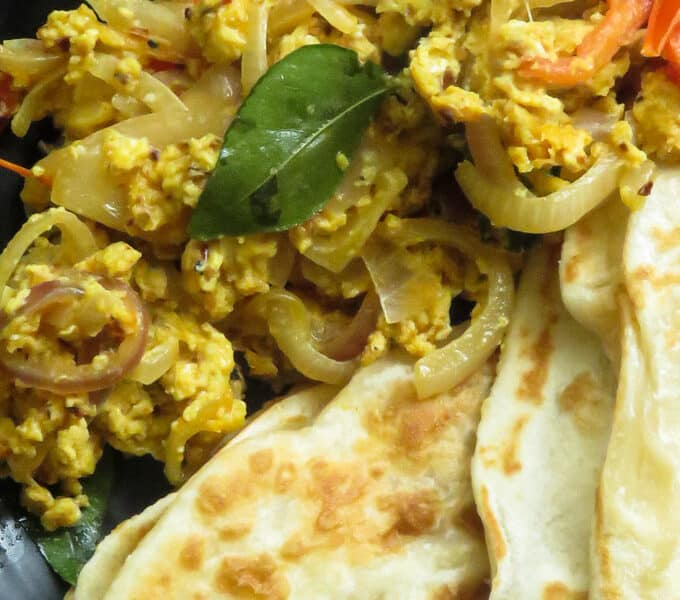 spicy scrambled eggs served with crispy parathas