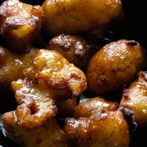 pisang goreng(mashed banana fritters in a bowl.