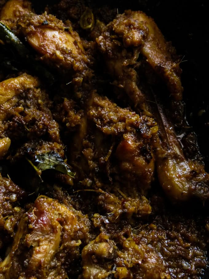 dry chicken rendang curry cooked in a wok