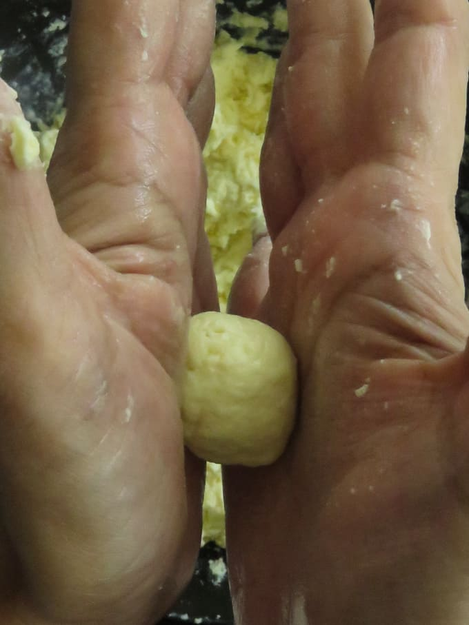using your palm to roll out the gulab jamun balls