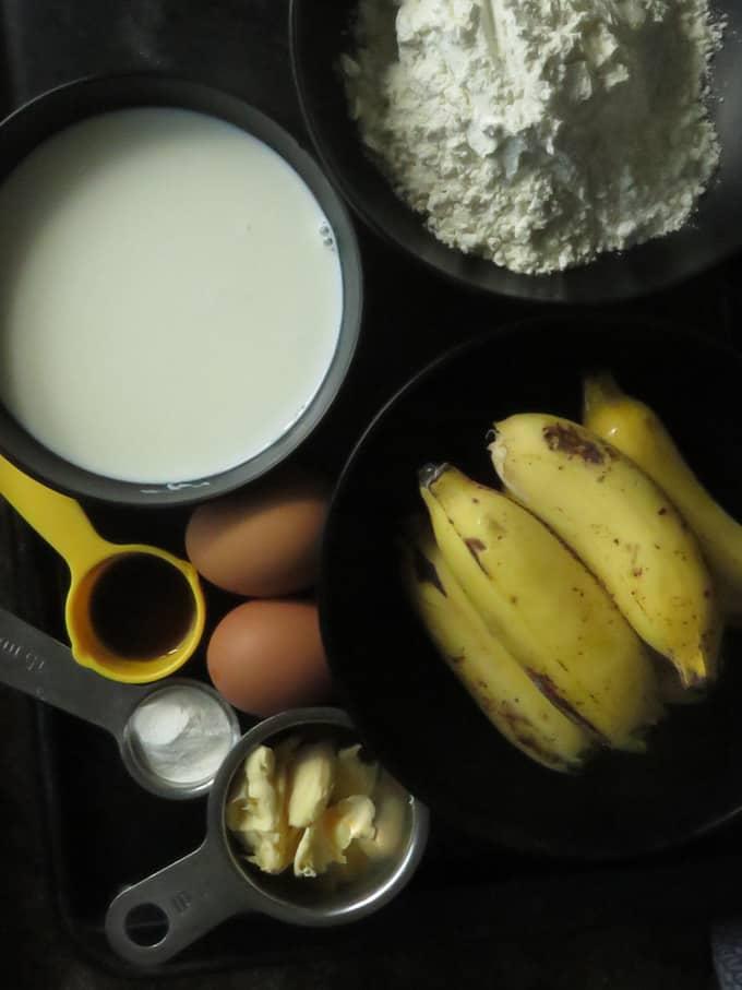 ingredients to make banana chocolate pancakes in a blender.