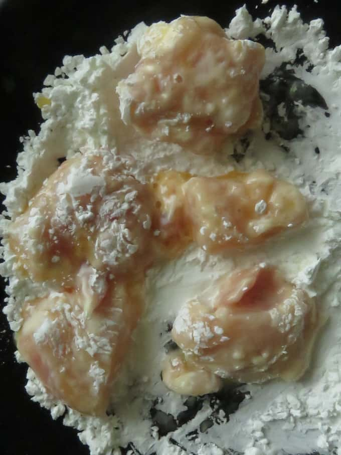 chicken cubes coated with cornflour to make chicken in and sour sauce