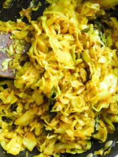 spicy cabbage stir fry in cooked with 5 ingredients in a frying pan.