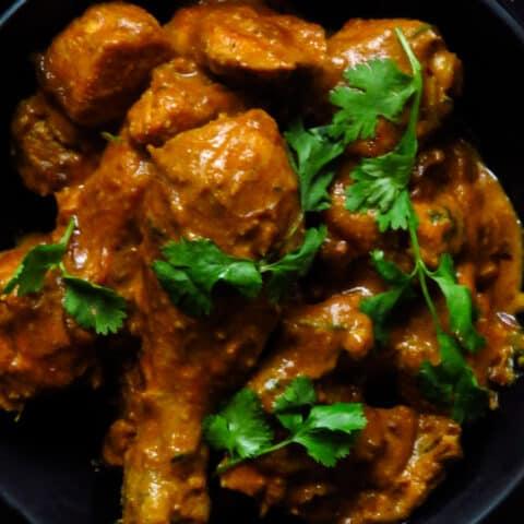 chicken mughlai curry in a bowl.