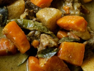 coconut beef stew with carrots and potatoes.