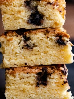 chocolate chunk blondies stacked on top of each other.