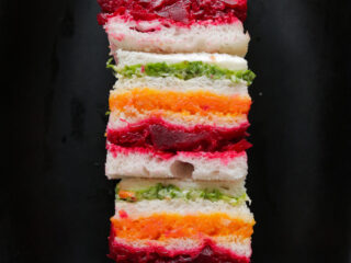 Stack of ribbon or rainbow sandwiches served on a platter