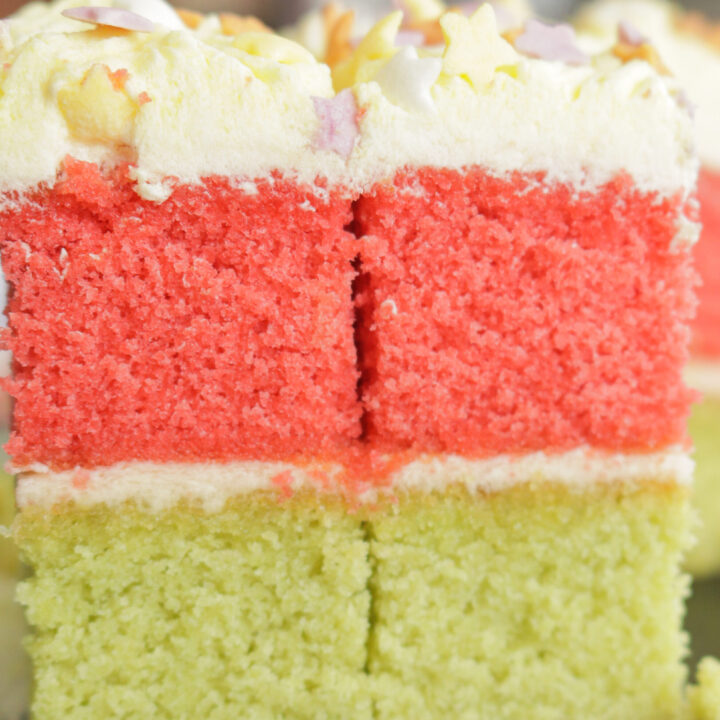 slices of ribbon cake with butter cream frosting.