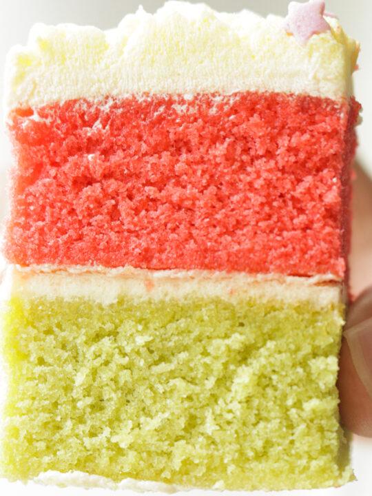 slice of ribbon cake held in hand